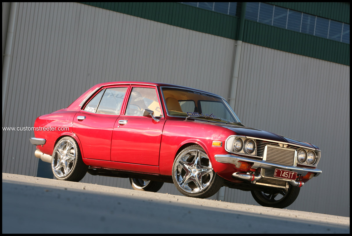 on www.customstreeter candy apple red mazda rx2 rotary with